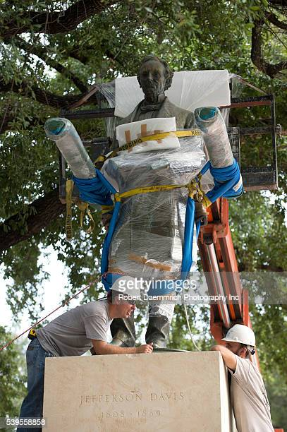 Statue of Confederate leader Jefferson Davis is removed from University of Texas' South Mall Sunday after UT President Gregory Fenves cleared it to...