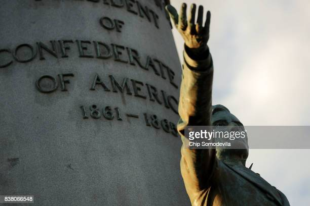 A statue of Confederate President Jefferson Davis unveild in 1907 stands in the middle of Monument Avenue August 23 2017 in Richmond Virginia...