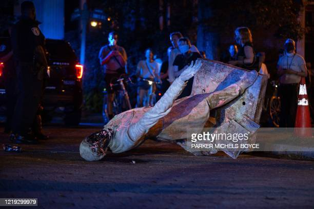 Statue of Confederate States President Jefferson Davis lies on the street after protesters pulled it down in Richmond, Virginia, on June 10, 2020. -...