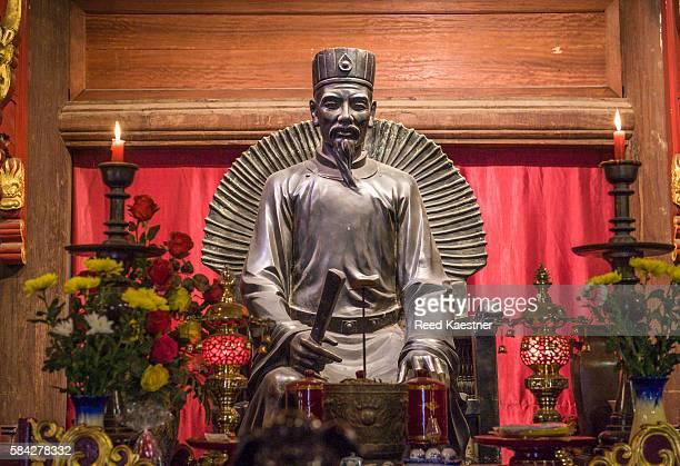 Statue of Confucius in the House of Ceremonies in the Temple of Literature, Hanoi, Vietnam