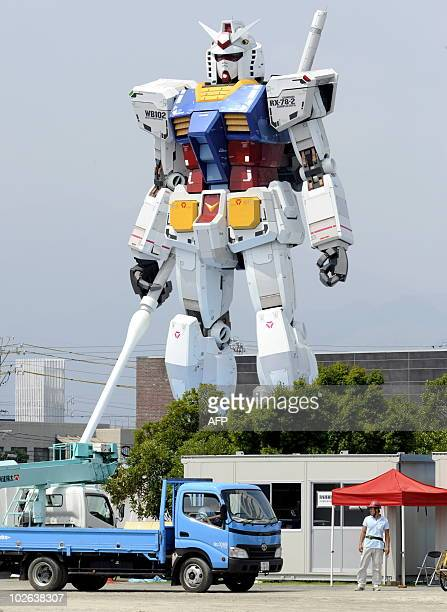 A statue of cult cartoon and comic book robot 'Gundam' stands at a park in Shizuoka city west of Tokyo on July 6 2010 The statue is being displayed...