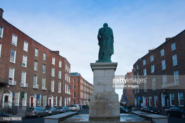 Statue of Daniel OConnell 6 August 1775 – 15 May 1847 with Georgian houses OConnell Street Limerick City Ireland