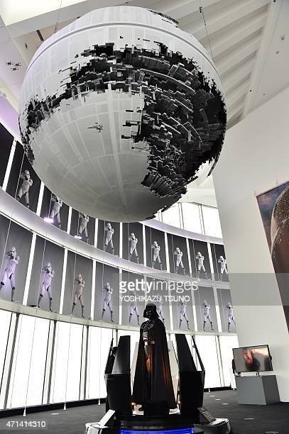 A statue of Darth Vader and a model of the Death Star are displayed at the preview of the Star Wars Vision' exhibition in Tokyo on April 28 2015 Star...