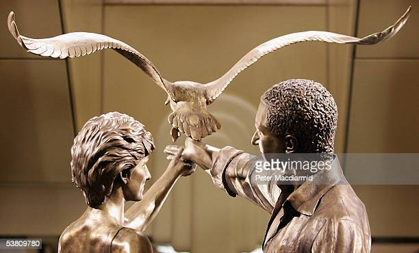 A statue of Diana Princess of Wales and Dodi Al Fayed is unveiled at Harrods department store on 1 September 2005 in London Harrods owner Mohamed Al...