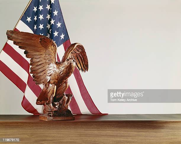statue of eagle with u.s. flag  - american flag eagle stock pictures, royalty-free photos & images