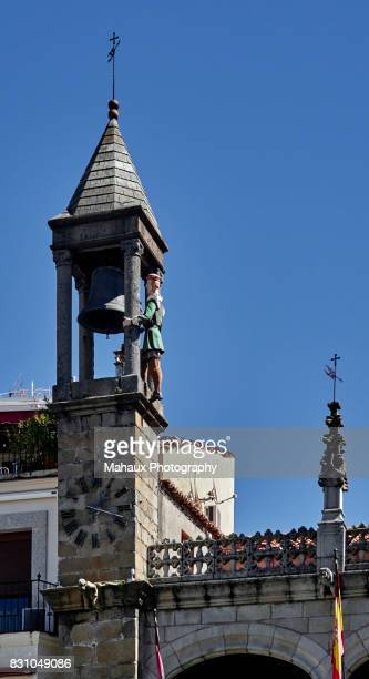 Statue of 'El abuelo Mayorga' on the bell tower of the town hall in Plasencia.