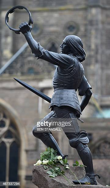 A statue of England's King Richard III is pictured outside Leicester Cathedral in Leicestershire central England on March 23 as members of the public...
