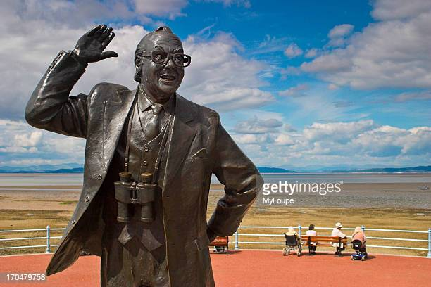 Statue of Eric Morecambe of Morecambe and Wise on the sea front at Morecambe Lancashire UK