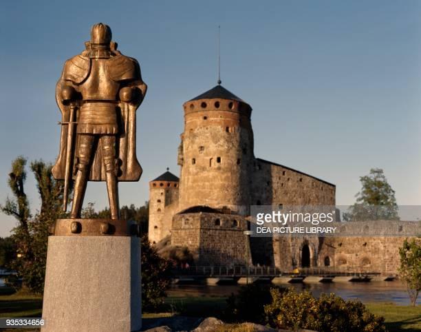 Statue of Erik Axelsson Tott in front of Olavinlinna castle Savonlinna Finland