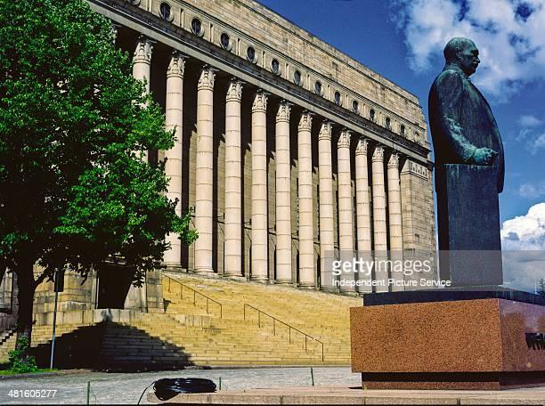Statue of Finnish President Pehr Evind Svinhufvud af Qvalstad in front of the Parliament Building in Helsinki Finland