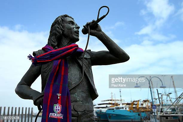 A statue of former ACDC lead singer Bon Scott is pictured wearing a Dockers scarf at Fishing Boat Harbour on September 24 2013 in Fremantle Australia...