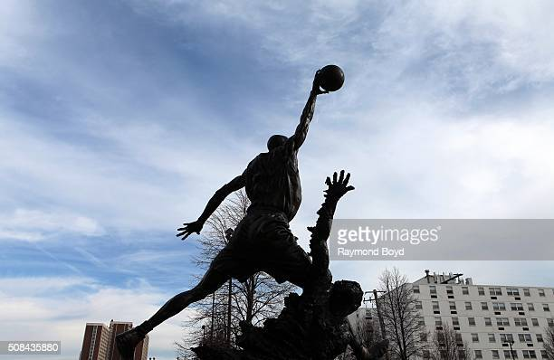 A statue of former Chicago Bulls basketball player Michael Jordan sits outside the United Center home of the Chicago Bulls basketball team and...