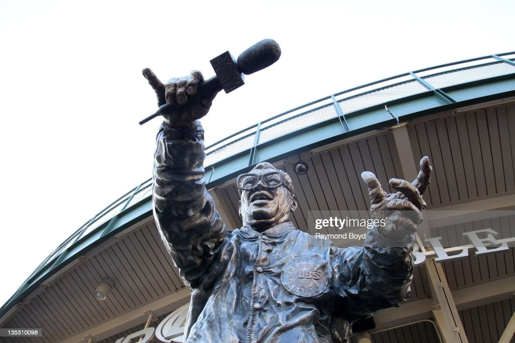 A statue of former Chicago Cubs broadcaster Harry Caray sits outside the center field bleachers at Wrigley Field, home of the Chicago Cubs, in Chicago, Illinois on DECEMBER
