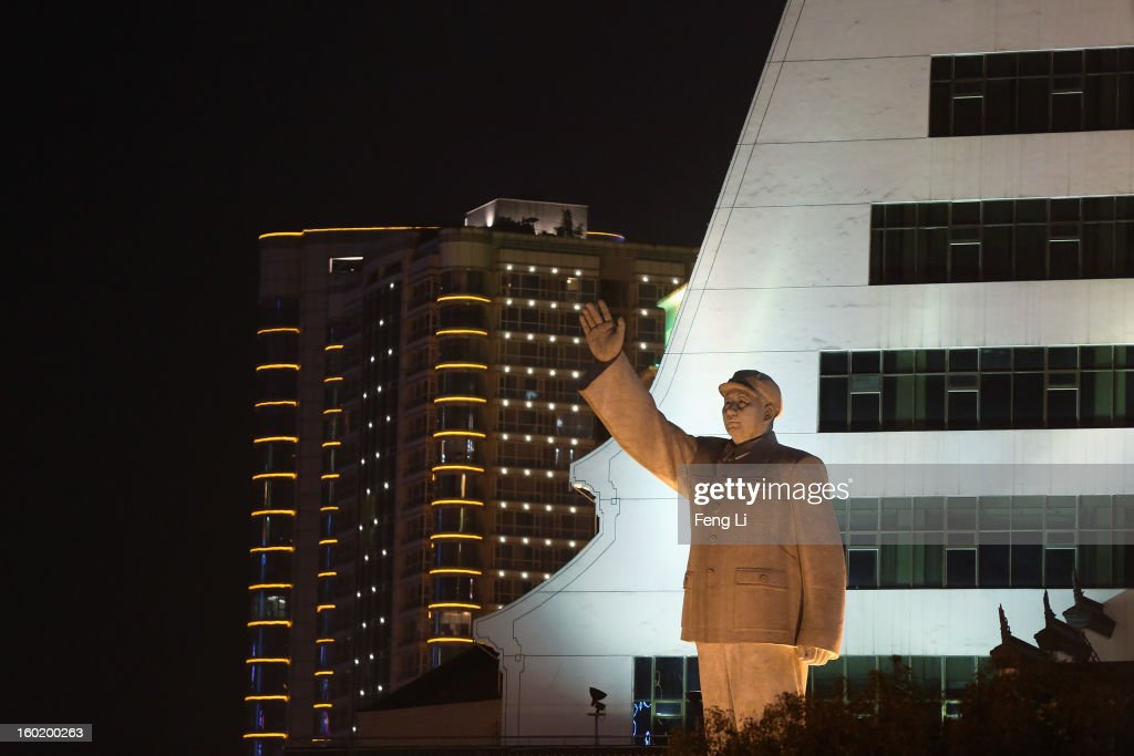 A statue of former Chinese leader Mao Zedong is seen in front of Guizhou Minority Cultural Palace on January 27, 2013 in Guiyang of Guizhou Province, China.
