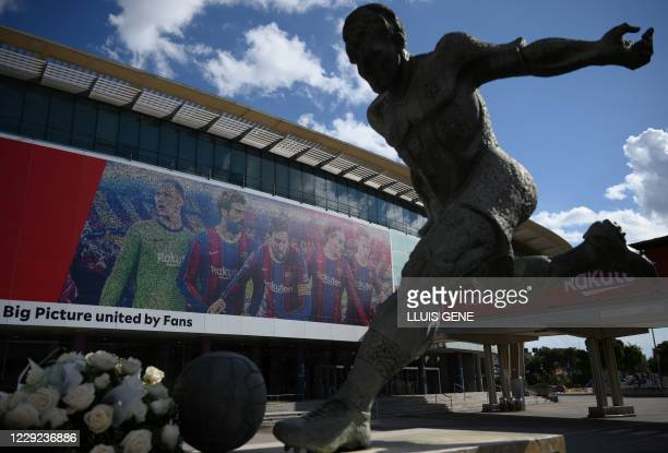 """Statue of former football player Ladislao Kubalae is pictured outside the Camp Nou stadium in Barcelona on October 23 on the eve of the """"clasico""""..."""