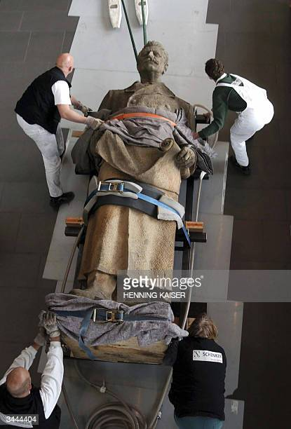 A statue of former Soviet leader Josef Stalin is ferried into Bonn's History Museum 19 April 2004 The 342metrehigh stone statue weighing in at 32...