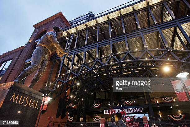 Statue of former St. Louis Cardinal Hall of Fame member, Stan Musial stands in the rain outside of Busch Stadium after game five of the NLCS between...