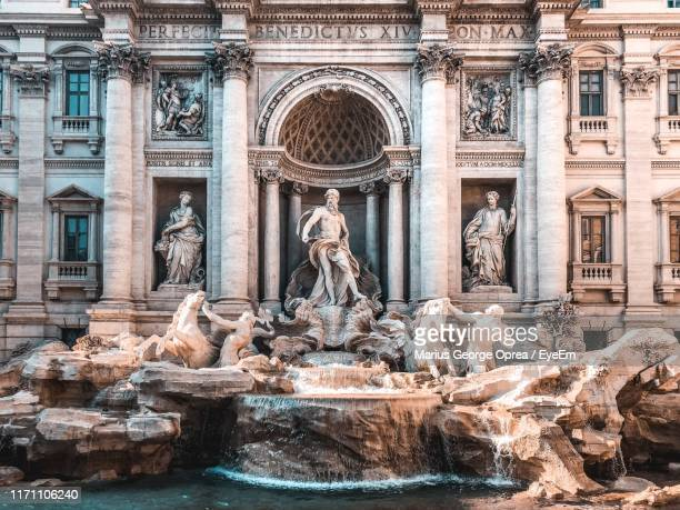statue of fountain in front of historical building - trevi fountain stock pictures, royalty-free photos & images