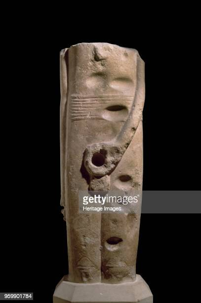 Statue of god Min 3300 BC Ithyphallic statue complete from above armpits to below knees Left hand holds phallus right arm elbow slightly bent hangs...