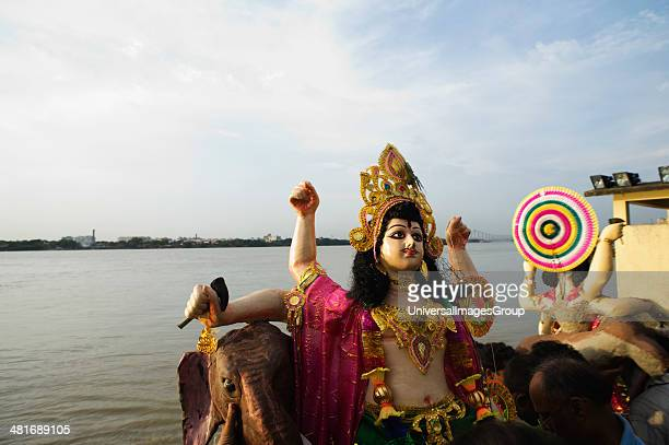 Statue of Goddess Durga before immersion at the river Hooghly River Kolkata West Bengal India
