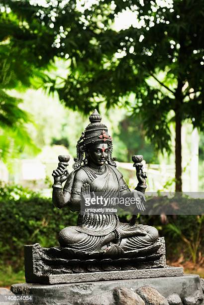 statue of goddess lakshmi in a zoo, mysore zoo, mysore, karnataka, india - goddess lakshmi stock photos and pictures