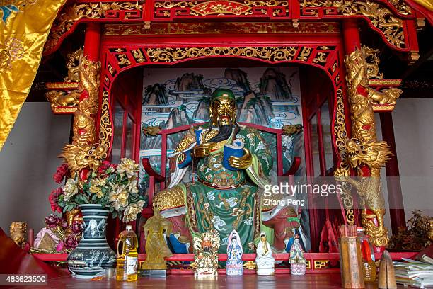 Statue of Guan Yu in the temple of Lord Guan who is the god of war in Chinese traditional culture Shipu Town sitting at the mountain and facing the...