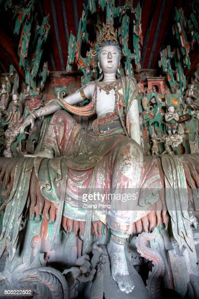 Statue of Guanyin Buddha in carefree posture The Shuanglin Temple is famous for more than 2000 colorful well preserved sculptures left from the Song...