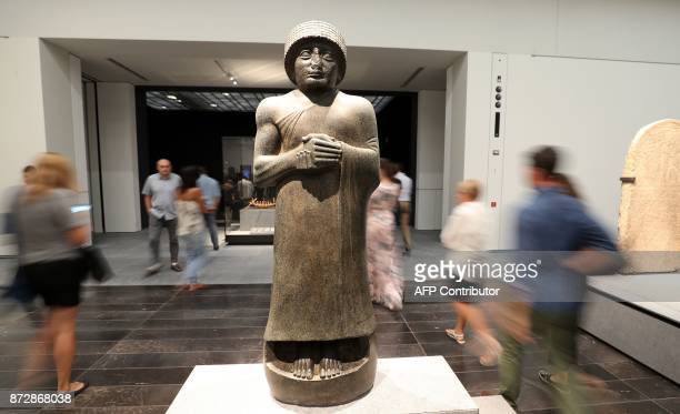 A statue of Gudea prince of the independent kingdom of Lagash in the late 3rd millennium is pictured during the opening of the Louvre Abu Dhabi...