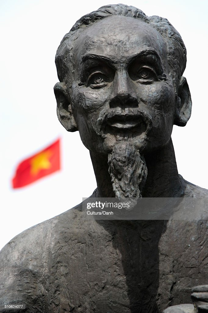 Statue of Ho Chi Minh with Vietnamese flag in background : Stock Photo