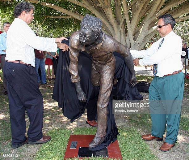 A statue of Indigenous cricketer Eddie Gilbert is unveiled by Wayne Coolwell and Larry Budd during the Cricket All*Star Fan Day part of the Emirates...