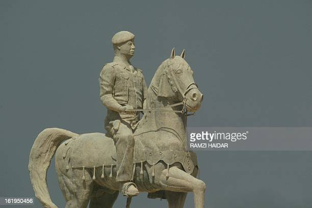 A statue of Iraqi President Saddam Hussein riding a horse sits in Baghdad 27 March 2003 AFP PHOTO/Ramzi HAIDAR
