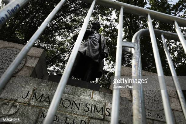 A statue of J Marion Sims a surgeon celebrated by many as the father of modern gynecology stands along an upper Manhattan street on August 23 2017 in...