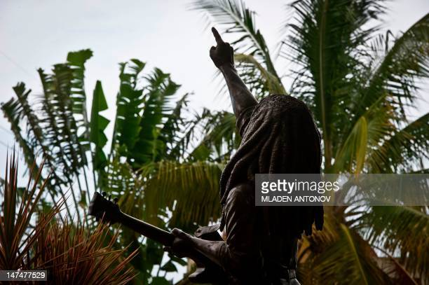 A statue of Jamaican Reggae legend Bob Marley welcomes visitors at his museum in Kingston on June 30 2012 Jamaica will celebrate its 50th anniversary...