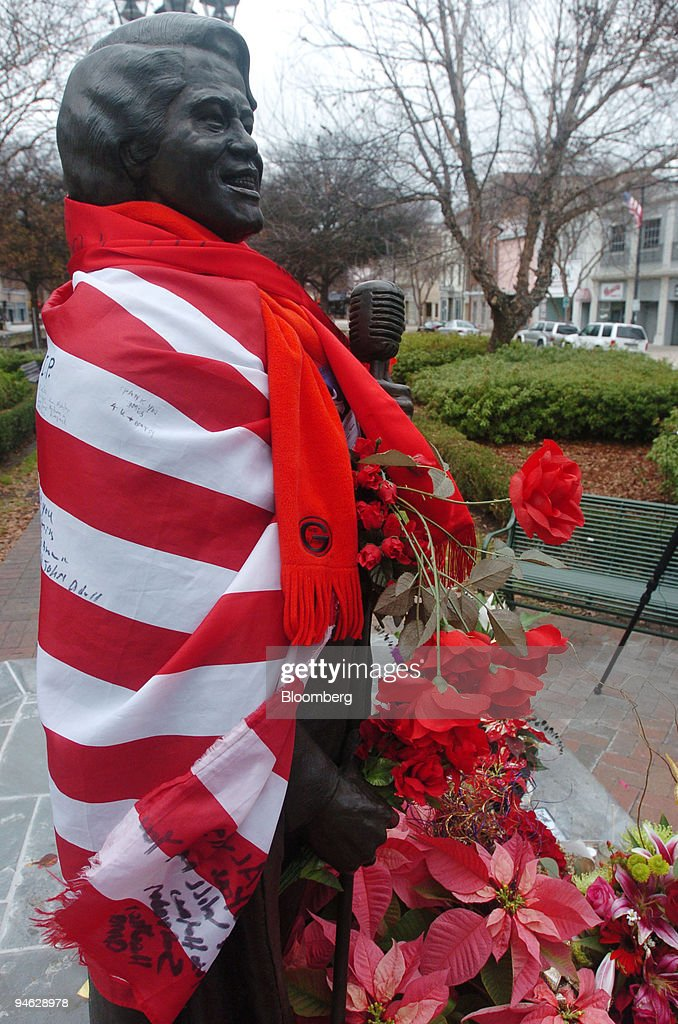 A statue of James Brown is draped with an American flag and : News Photo