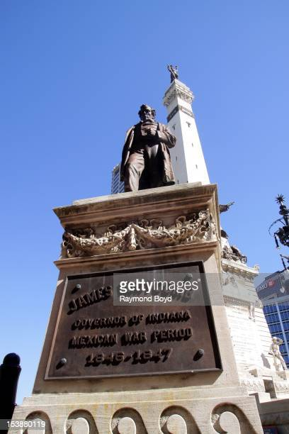 Statue of James Whitcomb Governor of Indiana during the Mexican War period sits in Monument Circle in Indianapolis Indiana on SEPTEMBER 30 2012