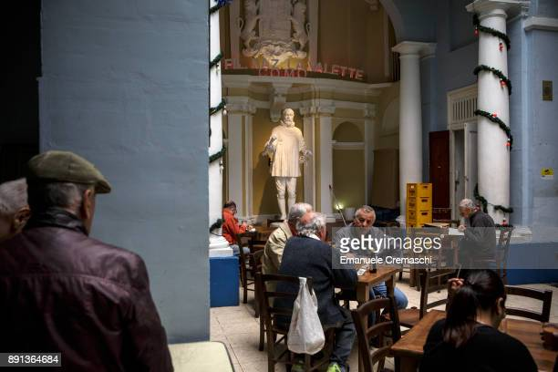 A statue of Jean Parisot de la Valette a French nobleman and Grand Master of the Order of the Knights of Malta stands inside a coffee shop on...