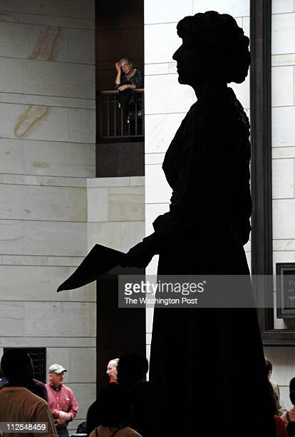 Statue of Jeannette Rankin, first woman elected to Congress, stands in Emancipation Hall, but statues of men far outnumber women in the US Capitol...