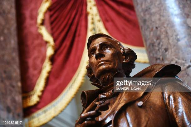 Statue of Jefferson Davis, president of the Confederate States, by artist Augustus Lukeman is seen in Statuary Hall of the US Capitol in Washington,...