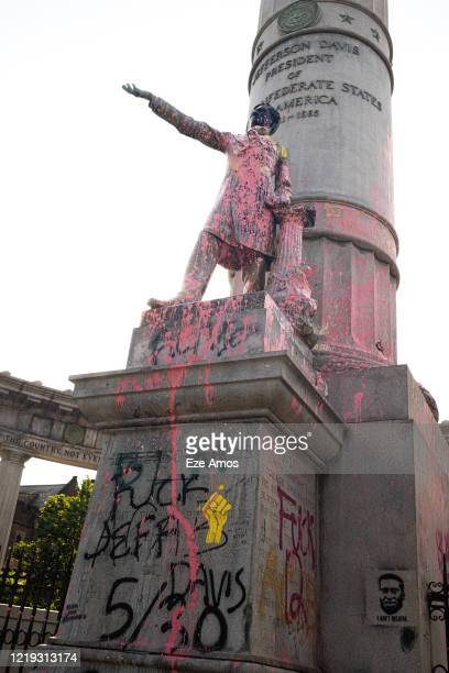 Statue of Jefferson Davis, the President of the Confederate States of America during the Civil War, is shown defaced with paint from ongoing...