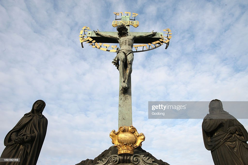 Statue of Jesus on the cross with Hebrew lettering on