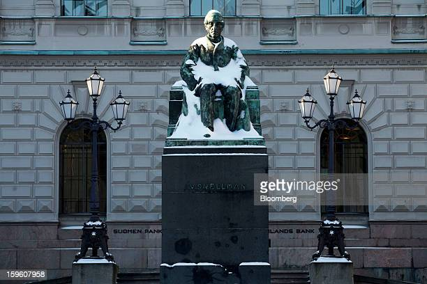 A statue of Johan Vilhelm Snellman stands outside the Finnish central bank in Helsinki Finland on Thursday Jan 17 2013 The pace of Finland's debt...