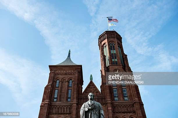 Statue of Joseph Henry, the first Secretary of the Smithsonian Institution, is seen in front of the Smithsonian Castle, the headquarters for the...