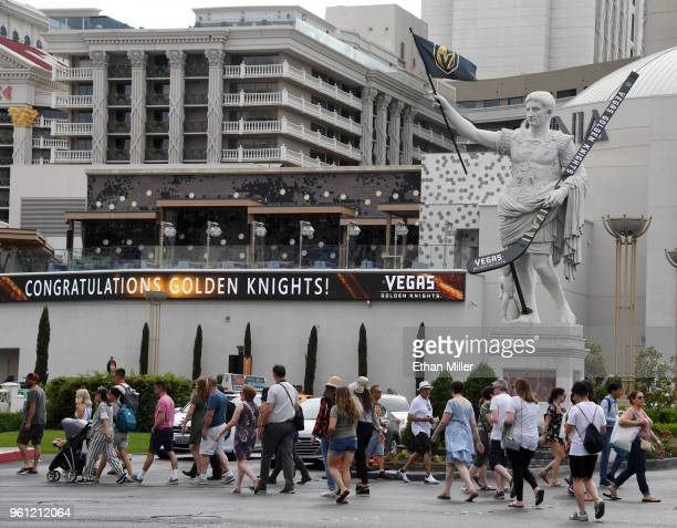A statue of Julius Caesar in front of Caesars Palace displays an oversized Vegas Golden Knights hockey stick and a flag with the team logo as an...