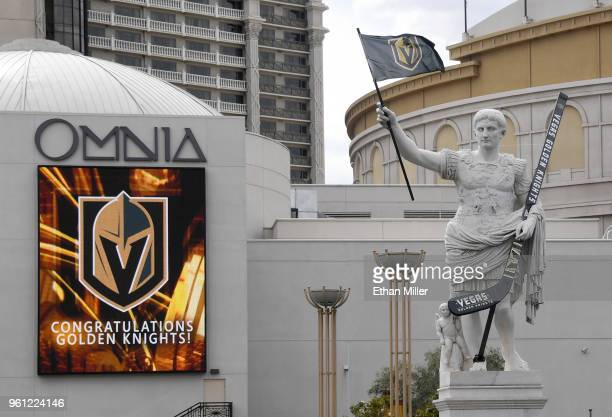 Statue of Julius Caesar in front of Caesars Palace displays an oversized Vegas Golden Knights hockey stick and a flag with the team logo as an...