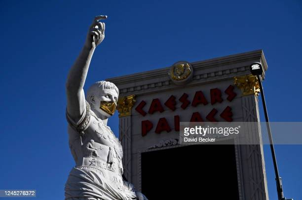Statue of Julius Caesar wears a mask at Caesars Palace on the Las Vegas Strip as the property opens for the first time since being closed on March 17...