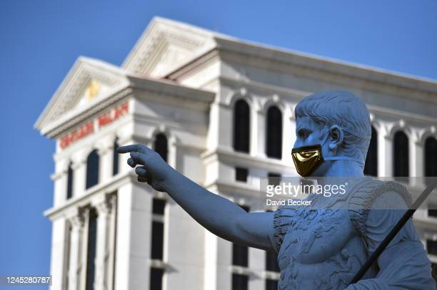 A statue of Julius Caesar wears a mask at Caesars Palace on the Las Vegas Strip as the property opens for the first time since being closed on March...