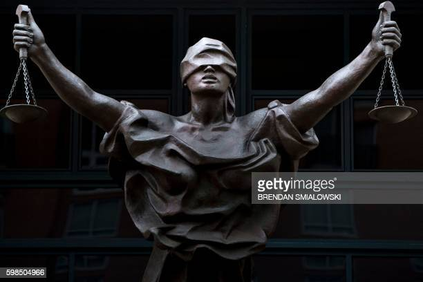 A statue of Justice is seen outside as a sentencing hearing takes place for Marcel Lehel Lazar a hacker known as Guccifer at the Albert V Bryan US...
