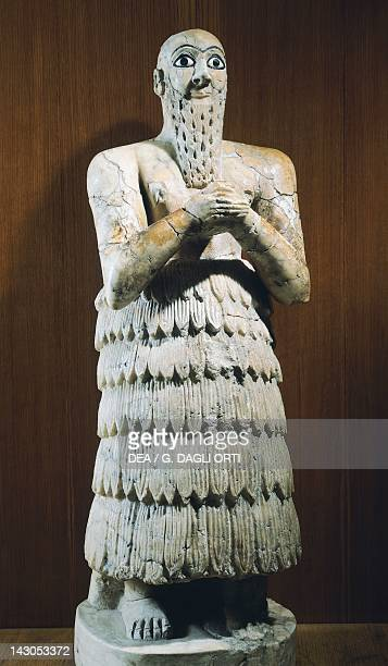 Statue of King IturShamagan in prayer wearing a cloak of wool sheep front view Artefact from Mari archeological site Syria Sumerian civilisation 3rd...