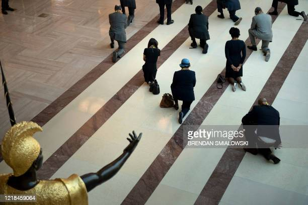 Statue of King Kamehameha I is seen as Democratic lawmakers take a knee to observe a moment of silence on Capitol Hill for George Floyd and other...