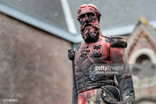 Statue of King Leopold II of Belgium is pictured on June 4, 2020 in Antwerp after being set on fire the night before as a petition was launched on...